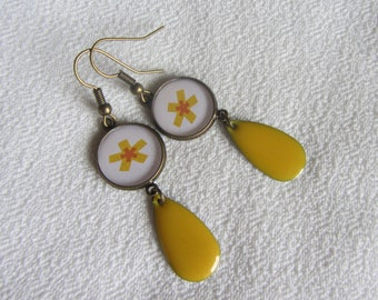Paper with yellow flower on white background, drop pendant dangle earrings with round cabochon enamelled yellow