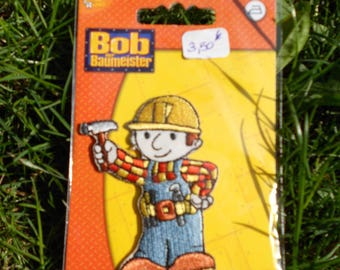 Coat BOB the Builder with his hammer to iron