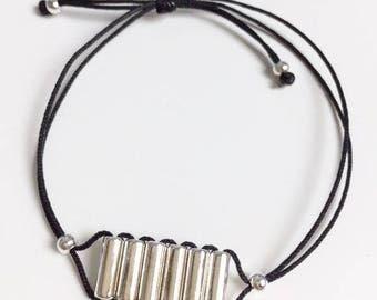 Row of tube bracelet