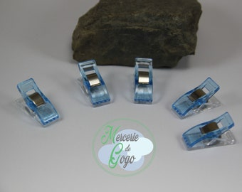 "Set of 5 blue ""CLOVER"" type clips."