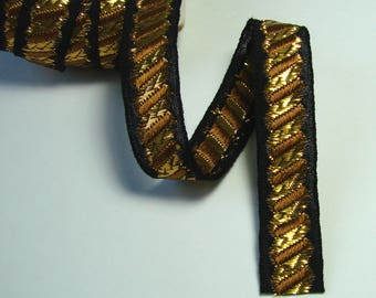 Ribbon, 14 mm, fancy, black and gold, the meter.