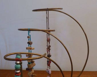 Bronze design display for jewelry