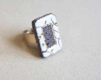 White rectangular ring enamelled lava and gold tracery
