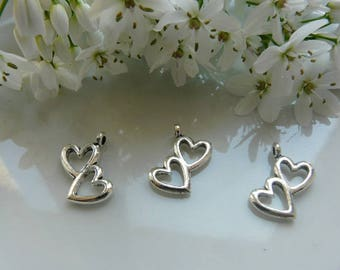Silver intertwined hearts pendant charm