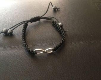 Black bracelet with infinity symbol