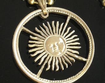 Sun, Argentinas 10 pesos cut coin pendant with necklace.