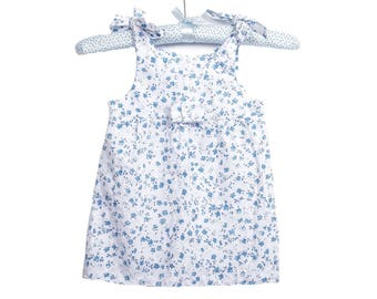 Little girl in blue embroidery floral dress