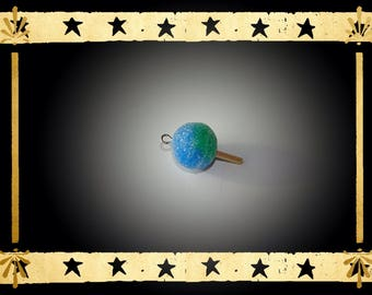 A tangy lollipop in blue and green translucent and wooden stick