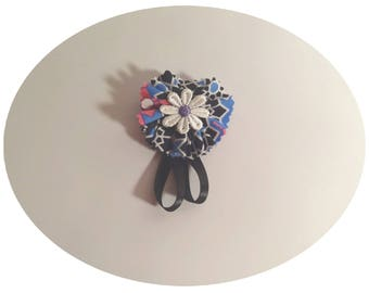 Brooch decorated with fabric