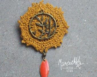 Brooch in twig - mustard yellow crochet