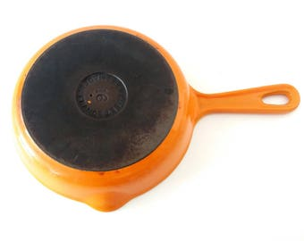 La Creuset enameled cast iron skillet, saute pan in flame orange