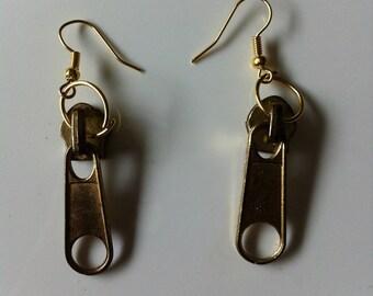 Pierced earrings by Golden Zips BAGART