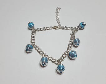 Bird cage charms and turquoise beaded bracelet