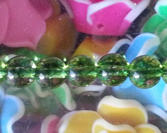 1 Pearl, quartz olivine 6 mm diameter, hole 1 mm