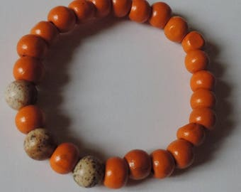 Beaded bracelet wood leaf and orange landscape.
