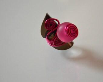 Fuchsia aluminum ring.