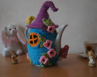 Decorated teapot is hand crocheted with acrylic yarn