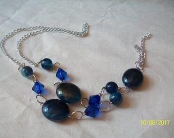 medium blue and silver bead, resin