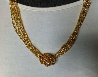 The Choker necklace with gold seed beads