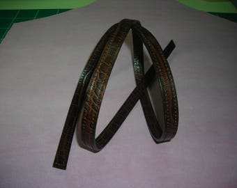 Shiny dark Havana Brown crocodile grain cowhide leather strap.