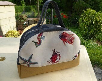 Marine with denim and leather bowling style bag