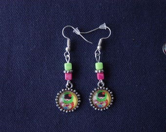 Earrings red and green Eskimo yellow background