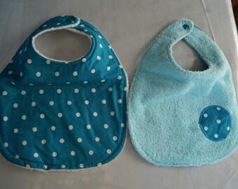 Several sets of 2 baby bibs