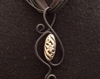 black and silver pendant