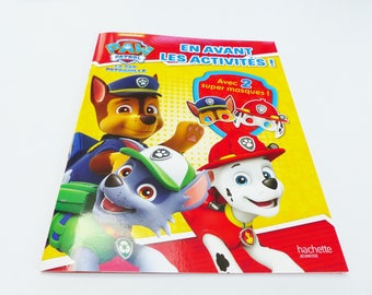 PAT patrol book in front with 2 paw patrol masks activities