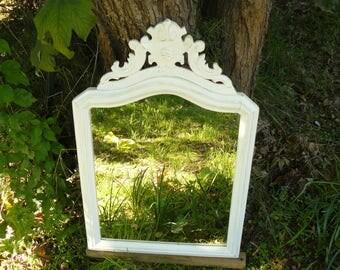 White mirror patinated with decorative pediment