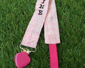 Pacifier clip with pink geometric patterns