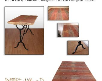 Table made of cast iron, pallet wood and Driftwood