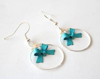 Small hoop earrings with blue bow