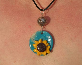 Pendant decorated with flowers in summer colours
