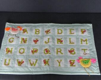 Green alphabet or when madame chicken teaches us the alphabet