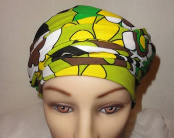 VINTAGE SPIRIT JERSEY CHEMO TURBAN HAT HAS FLOWERS YELLOW AND GREEN TO TIE AROUND THE HEAD IN ONE PIECE
