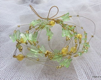 Delicate Garland of pearls green butterflies on metal wire