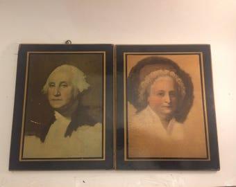 Vintage depression era pair of pressboard wall plaques featuring George and Martha Washington