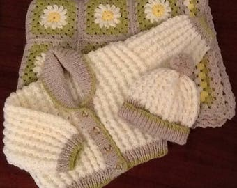 Crocheted Daisy pram blanket with matching shawl collared cardigan and hat.