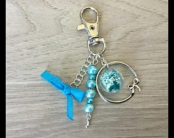 Bag charm with Pearl photoluminescent lampwork, satin ribbon and glass beads.