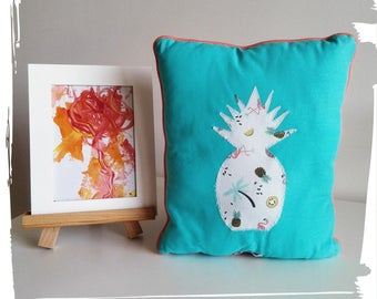 White, coral and turquoise pillow