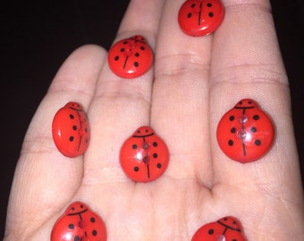 Red vibrant ladybird buttons in set of 11