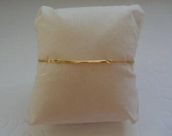 Tube on gold chain bracelet
