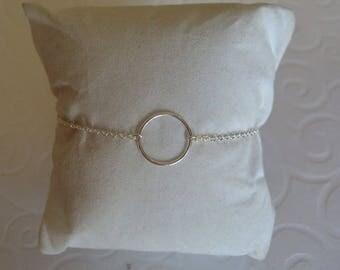 Circle bracelet on silver chain.