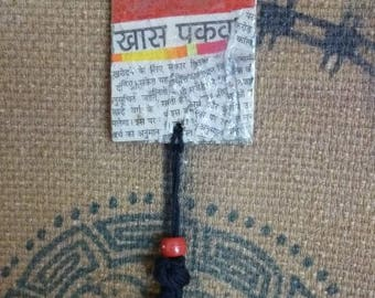 Pendant made of cardboard and newspaper writing Hindi