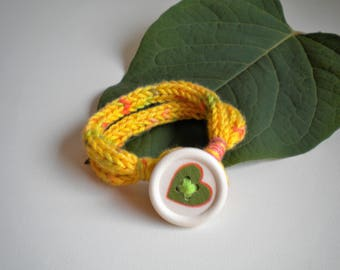 Knitted bracelet with button, 100% cotton yarn, yellow