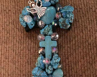 Small turquoise cross