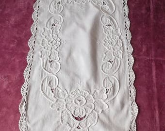 Surrounded by lace and embroidered very beautiful table runner