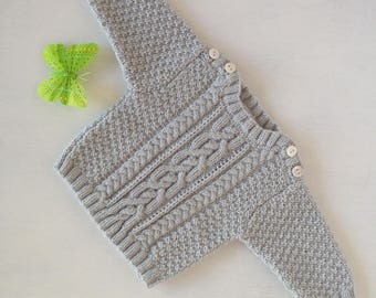 Newborn size grey cabled sweater