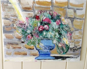 Potted flowers with stone wall